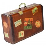 Vintage luggage - Vintage suitcase covered in stickers