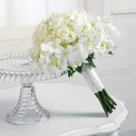 White bouquet of roses and stephanotis - wedding lusciousness