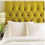Mustard yellow tufted headboard bedroom