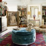 Blue tufted ottoman in a celebrity dressing room with chandelier and dog
