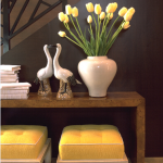 Yellow tulips and yellow stools in entryway