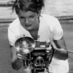young jackie bouvier kennedy onassis with a camera