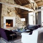 Stone fireplace with logs in country house