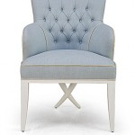 Armchair in pale blue with buttons
