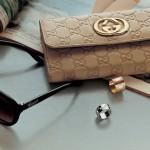 gucci clutch purse and sunglasses