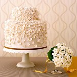 Pale pink and white themed wedding cake