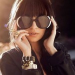 A glamorous life - Brunette wearing large black sunglasses