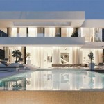 Images of modern houses in a garden setting with pool