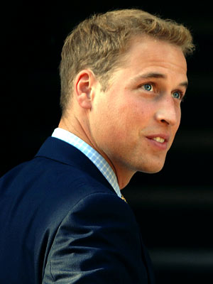 Prince William looking charming in a navy suit in his 20s