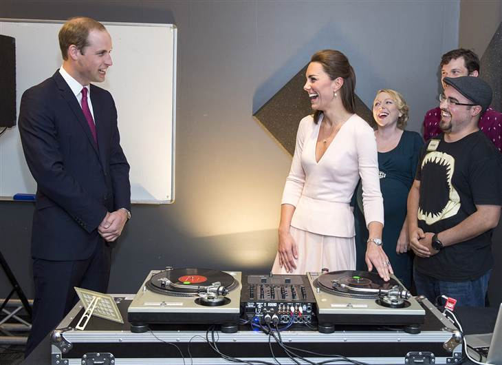 ROYAL, er, DJ STYLE: Kate Middleton in a soft pink long-sleeved Alexander McQueen top with v-neck and peplum detailing and a pleated A-line skirt