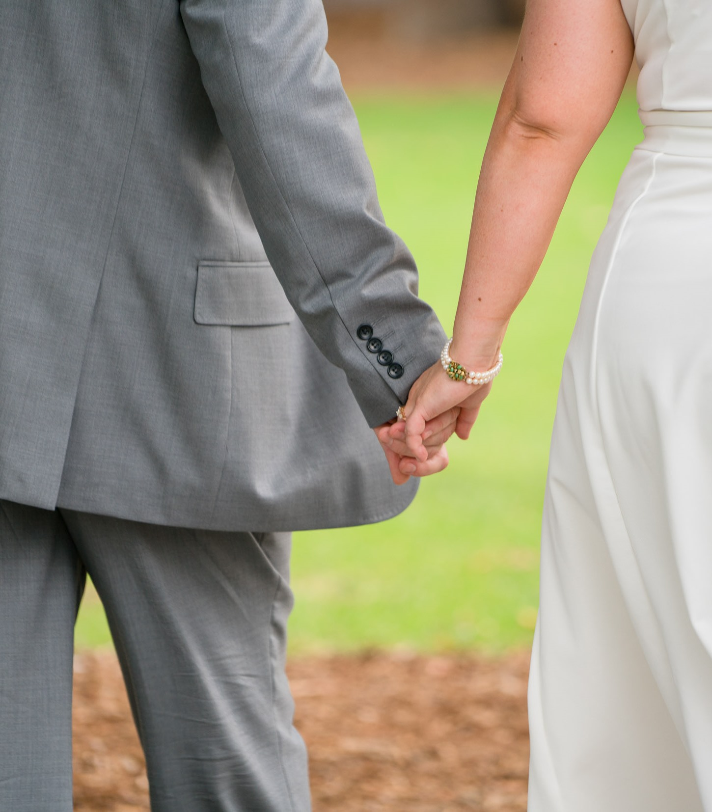 A Luscious wedding - In the Treasury Gardens - Mr and Mrs Luscious hand in hand