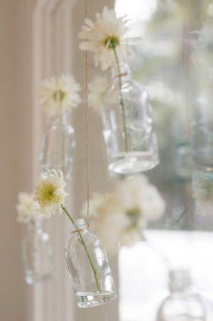 Different ideas for vases - bottles hanging by string with flowers.jpg