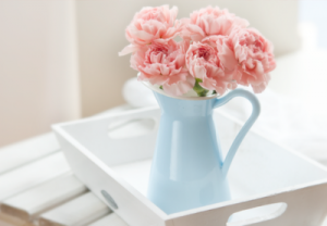 Different ideas for vases - jug blue pot vase with pink peonies.png