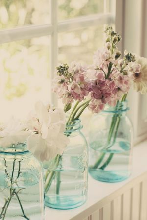 Flowers in vases - blue glass vases with flowers.jpg