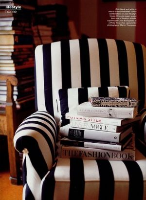 black and white chair with fashion books.jpg
