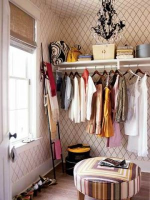 Rich and famous closets - black-chandelier-closet-space.jpg