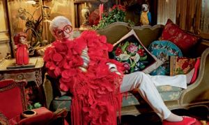 Iris Apfel with red feathers.jpg