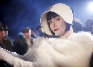 Essie Davis in white hat and coat - 1920s fashion inspiration.jpg