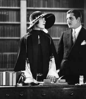 Flapper style - great gatsby Lois Wilson and Warner Baxter.jpg