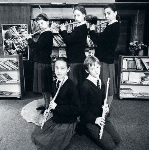 Playing the flute as a teenage girl - Kate Middleton as a child photos - school girl.jpg