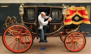 If it looks like rain on the big day then the Glass Coach built in 1881 and seen here at the Royal Mews in London will be used.JPG