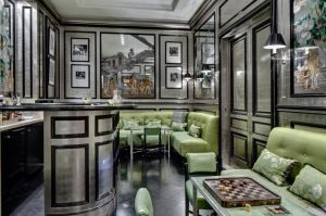 Bar area with silver black and grey ones and tufted green banquette seating via mylusciouslife.jpg