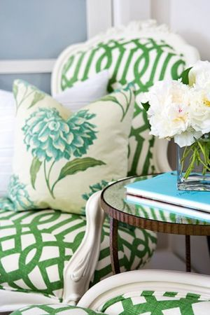 Beautiful green and white lattice pattern on armchairs with white peonies and floral teal cushions.jpg