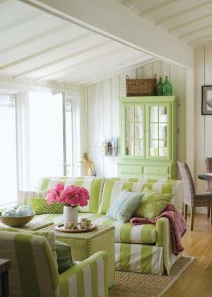 Bright lime green and white striped covers for family living room furniture via mylusciouslife.jpg