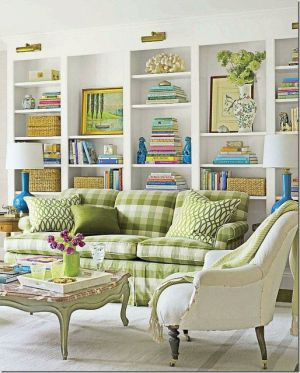 Colourful family friendly stylish living area with green plaid patterned couch and white shelving.jpg