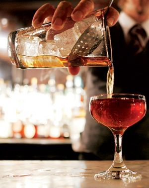Pouring cocktails photo - hire a barman for the night at your party.jpg