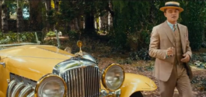 Jay with yellow car The Great Gatsby 2013 - fashion in film.PNG