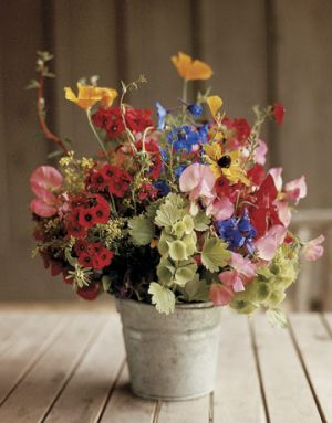 Use floral to bring in colour - Countryliving.com - Fresh Flowers in a Tin Pail.jpg