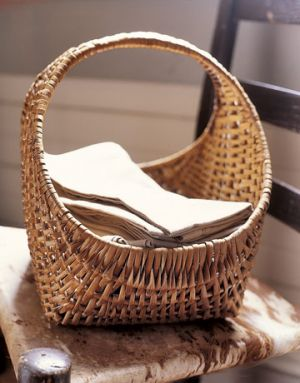 Countryliving.com - Basket on Antique Cowhide Chair.jpg
