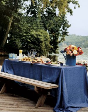Countryliving.com - Lakeside Table with lunch setting and colourful flowers.jpg