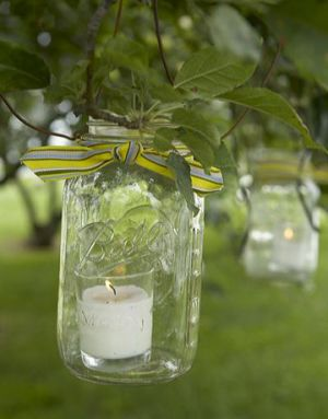 Countryliving.com - Sunflower Wedding - lantern hanging from tree.jpg