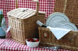 Picnic basket with silver and linen and red fabric.jpg