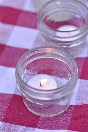 Picnic candles and checked pink white red table cloth.jpg