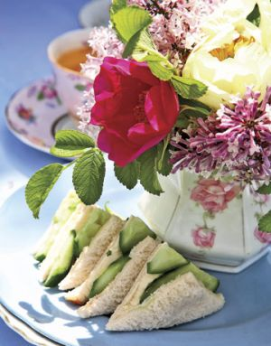 Picnic food ideas - Tea Party - floral tea cup and saucer with flowers in vase.jpg