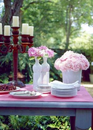 Picnic table designs - garden with table and pink flowers.jpg