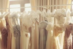 luscious cream and white evening frocks on rack - plan your wedding on a budget.jpg