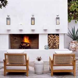 Photos - White beach house interiors - Ideas for decorating a beach house - shimmer-outdoor-fireplace.jpg