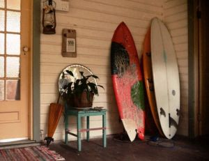 Relaxed private beach houses photos - beach house decor with surf boards.jpg