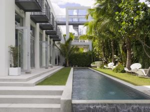 Modern house architecture with a pool and garden - 1 Kind Design Miami.jpg