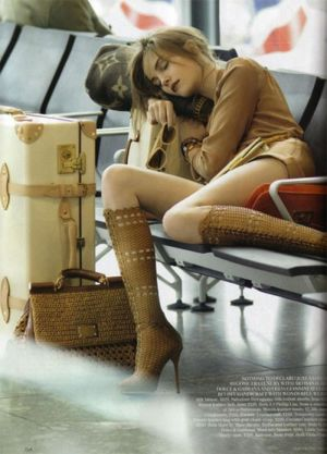 Travelling with Louis Vuitton, sleeping at airport.jpg