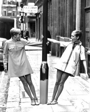 Two sixties models on the street hanging on to lamp.jpg