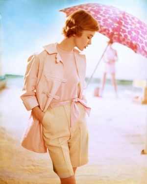 pink top and jacket pink umbrella beige shorts on beach - Tom-Palumbo.jpg