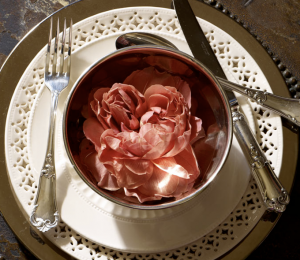 Dinner setting with peony in bowl.png