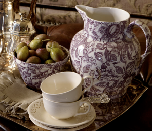 Tea cups and jug on tray.png
