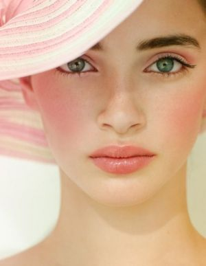 Think Pink - model with pale pink lips pink cheeks and pink sun hat.jpg