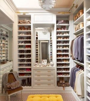 Master bedroom boudoir wardrobe design with tufted bench and shoe storage.jpg